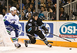 April 8, 2010; San Jose, CA, USA; San Jose Sharks defenseman Kent Huskins (40) skates past Vancouver Canucks right wing Mikael Samuelsson (26) during the first period at HP Pavilion. San Jose defeated Vancouver 4-2. Mandatory Credit: Jason O. Watson / US PRESSWIRE