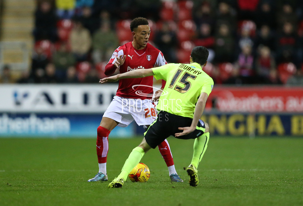 Rotherham United player Shay Facey (28) takes on Brighton winger, Jamie Murphy (15) during the Sky Bet Championship match between Rotherham United and Brighton and Hove Albion at the New York Stadium, Rotherham, England on 12 January 2016.