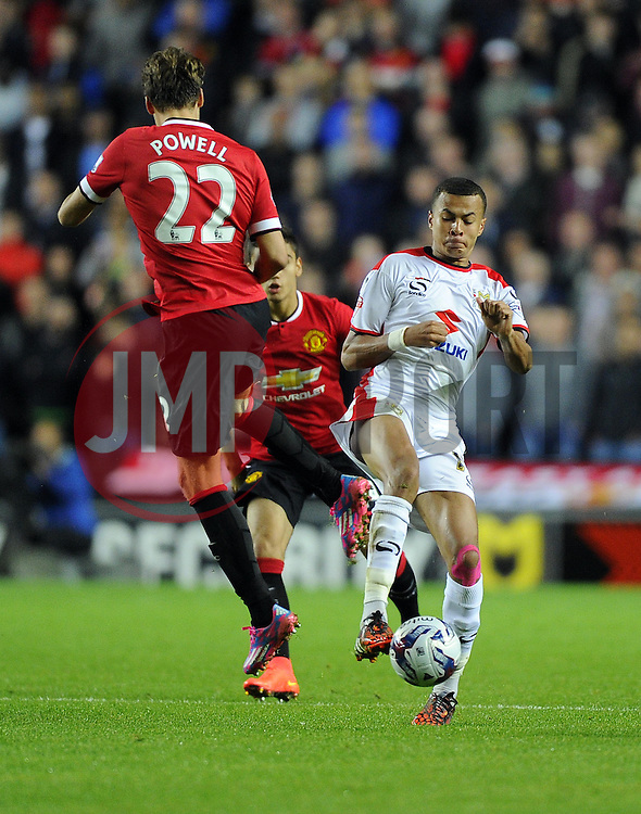 Milton Keynes Dons' Dele Alli battles for the ball with Manchester United's Nick Powell - Photo mandatory by-line: Joe Meredith/JMP - Mobile: 07966 386802 26/08/2014 - SPORT - FOOTBALL - Milton Keynes - Stadium MK - Milton Keynes Dons v Manchester United - Capital One Cup