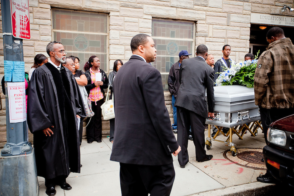Washington, Oct. 6, 2010 - Funeral for Jamal Coates -  The casket containing Jamal Coates is brought from the funeral to the hearse. (Photo by Jay Westcott/TBD)