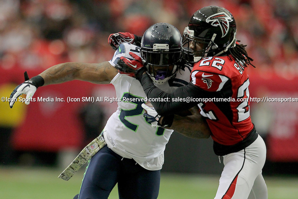 10 November 2013: Seattle Seahawks running back Marshawn Lynch (24) is wrapped up by Atlanta Falcons cornerback Asante Samuel (22) in the Seattle Seahawks 33-10 victory over the Atlanta Falcons at the Georgia Dome in Atlanta Georgia.