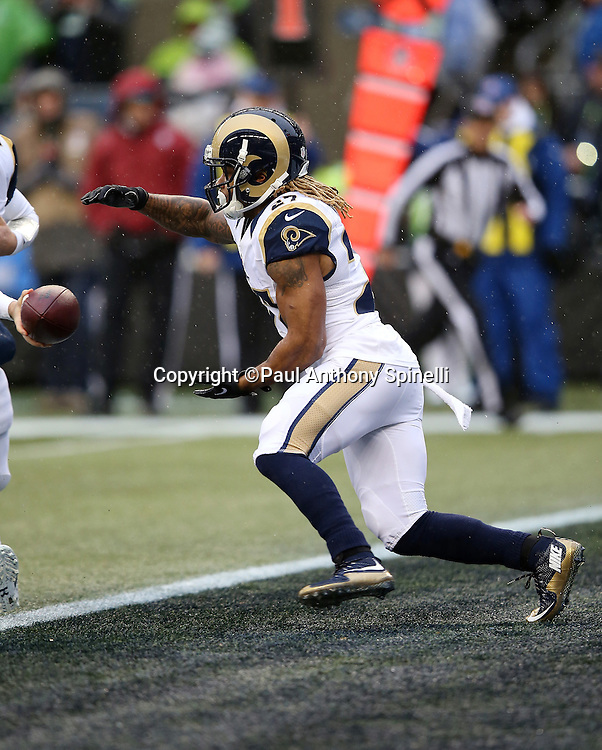 St. Louis Rams running back Tre Mason (27) takes a handoff as he runs the ball from his own end zone during the 2015 NFL week 16 regular season football game against the Seattle Seahawks on Sunday, Dec. 27, 2015 in Seattle. The Rams won the game 23-17. (©Paul Anthony Spinelli)