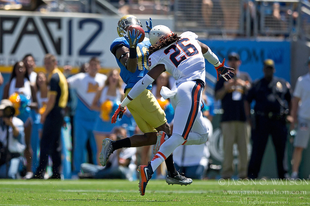 PASADENA, CA - SEPTEMBER 05:  Cornerback Maurice Canady #26 of the Virginia Cavaliers breaks up a pass intended for wide receiver Kenneth Walker III #10 of the UCLA Bruins during the first quarter at the Rose Bowl on September 5, 2015 in Pasadena, California. The UCLA Bruins defeated the Virginia Cavaliers 34-16. (Photo by Jason O. Watson/Getty Images) *** Local Caption *** Maurice Canady; Kenneth Walker III