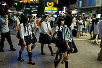 Schoolgirls on their way to catch their train home, Shibuya station, Tokyo, Japan.