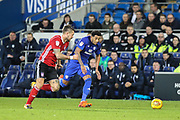 Nathaniel Mendez-Laing of Cardiff City and Luke Chambers of Ipswich Town during the EFL Sky Bet Championship match between Cardiff City and Ipswich Town at the Cardiff City Stadium, Cardiff, Wales on 31 October 2017. Photo by Andrew Lewis.