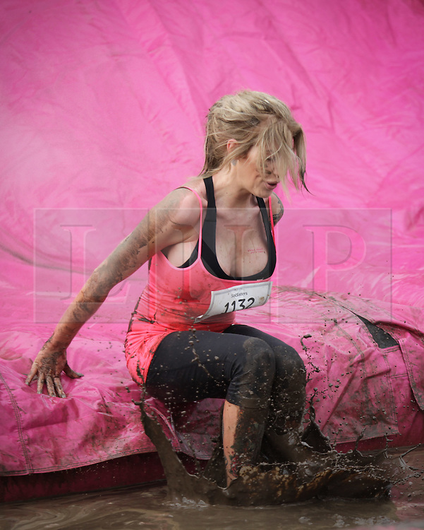 © Licensed to London News Pictures. 03/10/2015. Portsmouth, Hampshire, UK. Women taking part in the 'Pretty Muddy' Race for Life 5k event on Southsea Common in Portsmouth, Hampshire this morning, Saturday 3rd October 2015. The fundraising event involves women running, jogging and walking 5k to raise money for Cancer Research UK. Photo credit : Rob Arnold/LNP