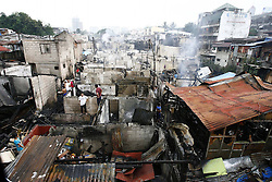 60643324  <br /> Residents look for reusable materials after a fire hit a slum area in Makati City, the Philippines, Oct. 27, 2013. More than 500 shanties were razed in the fire, leaving 2,000 families homeless and two children killed, on Sunday, 27th October 2013. Picture by  imago / i-Images.<br /> UK ONLY