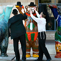 "Ultra Orthodox Jewish men put their hats on one of the ""United Buddy Bears 2007"" near the Jerusalem City Hall on July 31, 2007.  Some 138 ""Buddy Bears"" were created by 123 artists from 138 countries to promote tolerance and international understanding. The Buddy Bears were financed by different sponsors and will be auctioned with the proceeds going to UNICEF after a world tour. Photo By Michal Fattal/FLASH90"
