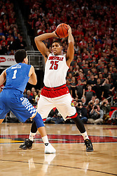 Louisville guard/forward Wayne Blackshear, right, looks for an open teammate in the second half. Kentucky won 58-50.<br /> <br /> The University of Louisville hosted the University of Kentucky, Saturday, Dec. 27, 2014 at Yum Center in Louisville. <br /> <br /> Photo by Jonathan Palmer