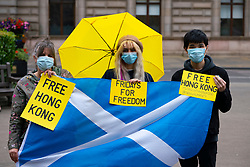 Glasgow, Scotland, UK. 17 July, 2020. Protesters from The Democracy in Hong Kong in Scotland group at a Fridays for Freedom Hong Kong democracy protest held in George Square Glasgow and in other major cities around the world today. Fridays for Freedom protests are intended to highlight the attack on human rights and freedom by the Chinese Government on Hong Kong and in China. Further Friday protests are planned in the following weeks. Iain Masterton/Alamy Live News