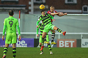 Forest Green Rovers Charlie Cooper(15) heads the ball during the EFL Sky Bet League 2 match between Exeter City and Forest Green Rovers at St James' Park, Exeter, England on 26 December 2017. Photo by Shane Healey.
