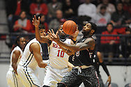 "Mississippi Rebels guard Ladarius White (10) fouls South Carolina Gamecocks guard Sindarius Thornwell (0) at the C.M. ""Tad"" Smith Coliseum in Oxford, Miss. on Saturday, January 10, 2015. (AP Photo/Oxford Eagle, Bruce Newman)"