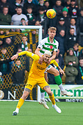 Kristoffer Ajer (#35) of Celtic FC outjumps Lyndon Dykes (#9) of Livingston FC during the Ladbrokes Scottish Premiership match between Livingston FC and Celtic FC at The Tony Macaroni Arena, Livingston, Scotland on 6 October 2019.