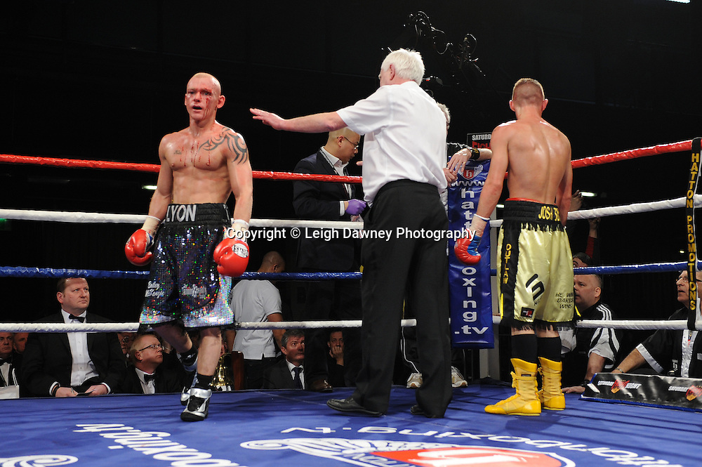Craig Lyon (black/silver shorts) v Josh Wale. Referee stops fight after both boxers have cuts above the left eyes following an accidental clash of heads. Premier Suite, Reebok Stadium, Bolton on Saturday 26th February 2011. Hatton Promotions. Photo credit © Leigh Dawney.