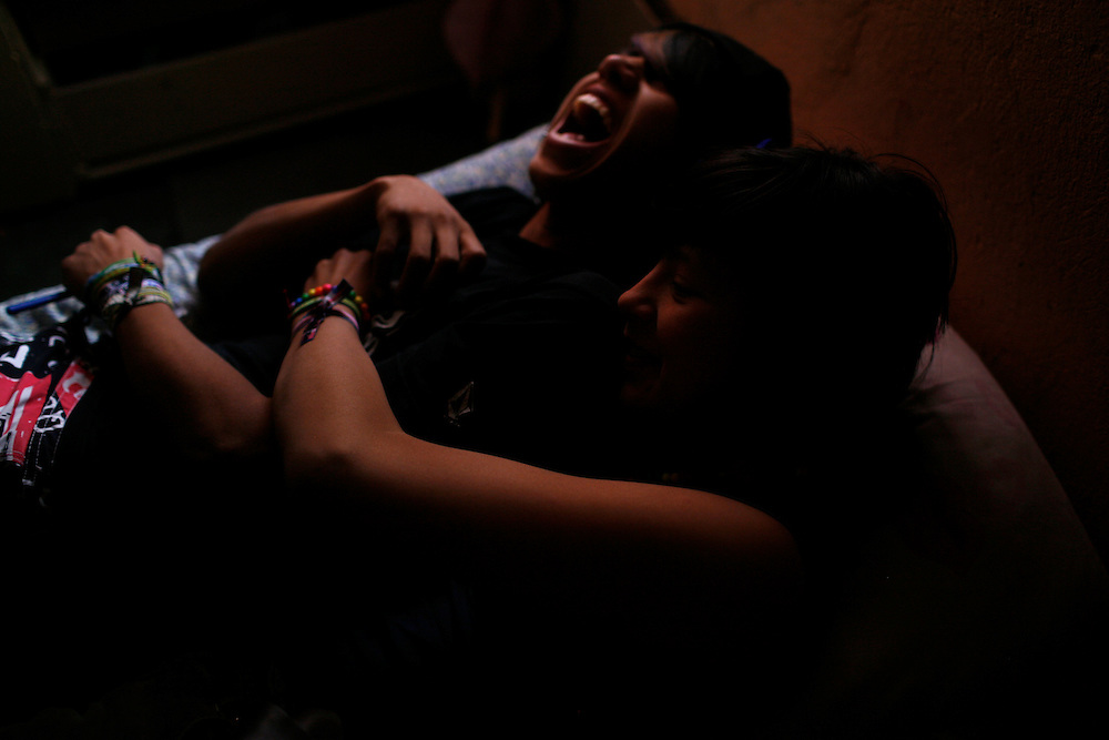 From left, Joe Miguel, 16 and Denise Fuentes 14, share a moment in the Diaz Ordaz colonia in Ciudad Juarez, Chihuahua Mexico on April 28, 2010. .