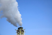 industrial smokestack billowing smoke
