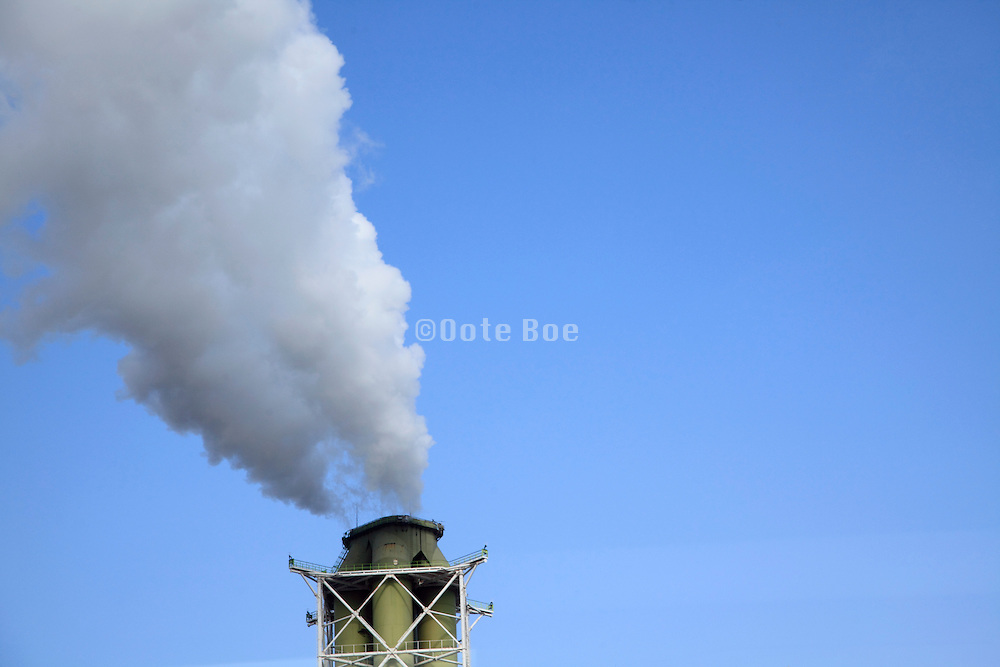 industrial smokestack billowing smoke