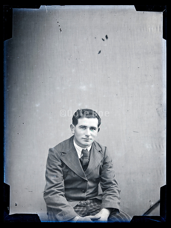 studio portrait of a young adult man in suit circa 1920s