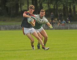 Ballinrobe&rsquo;s David Morrin tries to evade The Neale&rsquo;s David O&rsquo;Connor during the Intermediate clash.<br />Pic Conor McKeown