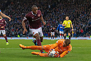Allan McGregor of Rangers FC quick off his line to deny Uche Ikpeazu of Hearts during the Betfred Scottish League Cup semi-final match between Rangers and Heart of Midlothian at Hampden Park, Glasgow, United Kingdom on 3 November 2019.
