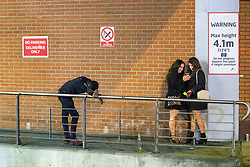 © Licensed to London News Pictures . 01/01/2018. Manchester, UK. A man stands slumped over a railing by the Arndale Centre . Revellers celebrate the start of the New Year in Manchester City Centre . Photo credit: Joel Goodman/LNP
