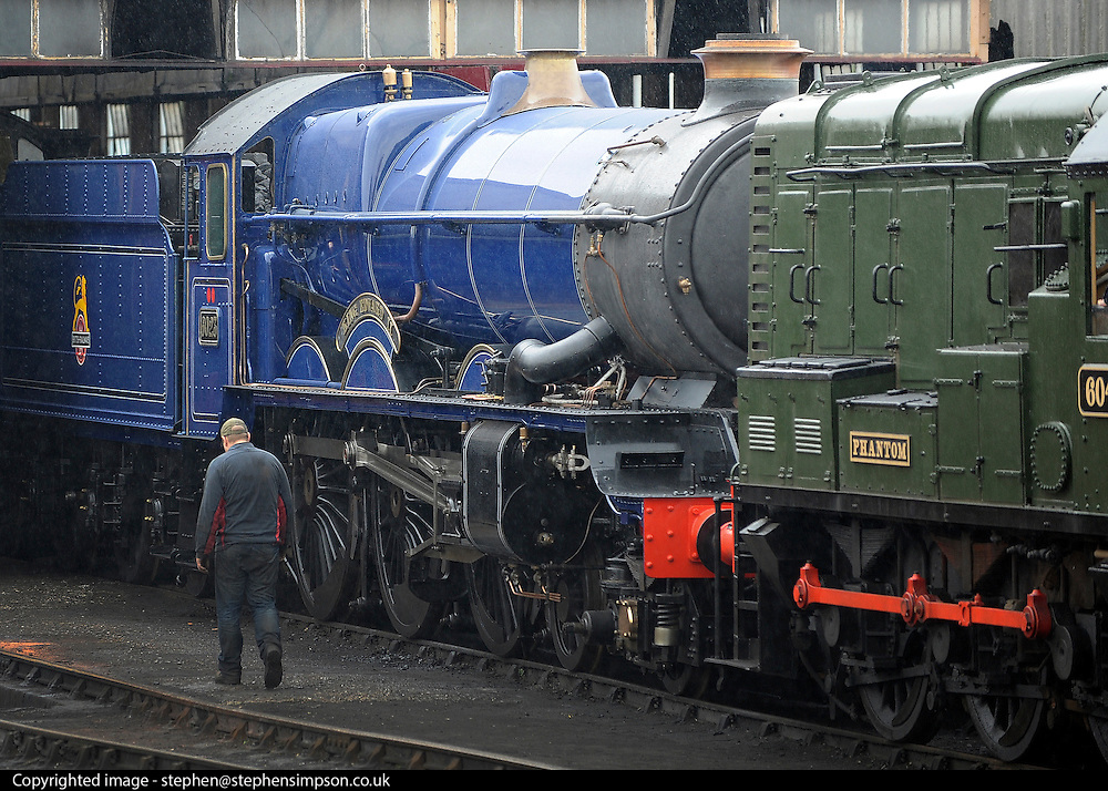 London News pictures. 30/03/2011. The King Edward II steam locomotive is moved from her protective shed at the Railway Centre in Oxfordshire, England, on 30th March 2011, ahead of her public unveiling this weekend. A small group of volunteer workers met every two weeks and completed the restoration of the engine, once destined for the scrap heap, after 20 years. King Edward II is a Great Western Railway (GWR) heavy express steam locomotive, one of only three surviving members of this class of locomotive. King Edward II performed over 1,500,000 miles of service pulling trains between London Paddington and the West of England, and also in latter years between Paddington and South Wales or Wolverhampton. Introduced in the 1920s for taking express trains over the steep gradients (banks) of South Devon, the Kings were withdrawn in the early 1960s as diesel locomotives replaced them. 6023 spent many years rotting at Barry Scrapyard, and had her rear driving wheels cut through with an oxy-acetylene torch after a shunting accident. . Picture credit should read Stephen Simpson/LNP