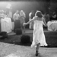 Barcelona, Spain.   Girl runs across the lawn at a wedding in Barcelona, Spain.<br /> Cathy Loughran