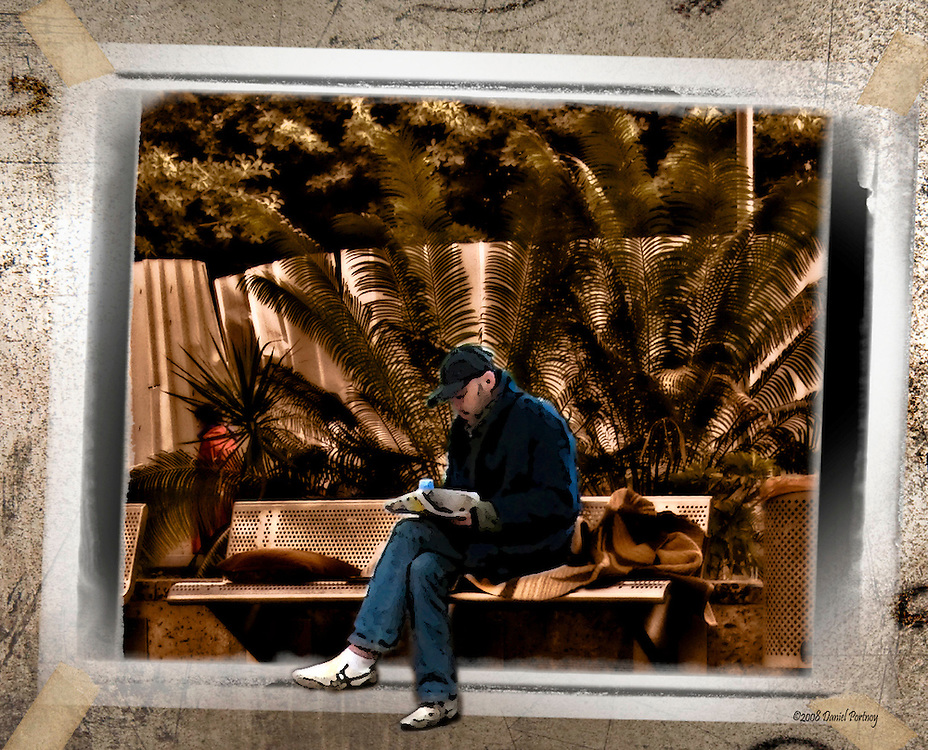 Homeless reading on park bench in Herzliya Israel