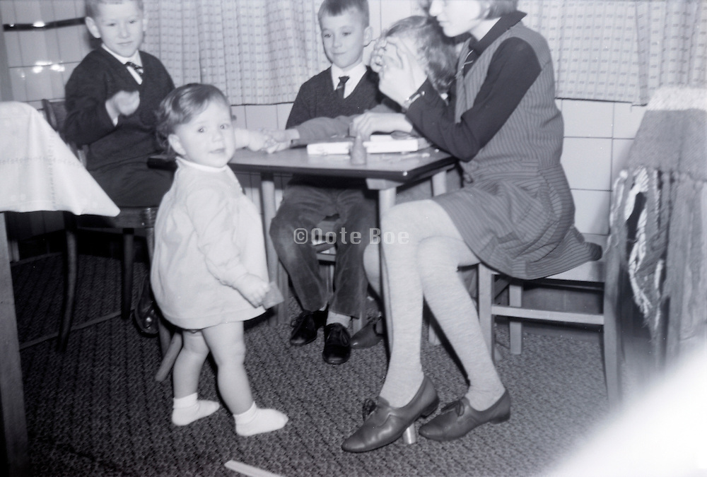 children gathering playing indoors game 1960s