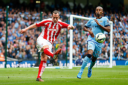 Charlie Adam of Stoke clears past Fernandinho of Manchester City - Photo mandatory by-line: Rogan Thomson/JMP - 07966 386802 - 30/08/2014 - SPORT - FOOTBALL - Manchester, England - Etihad Stadium - Manchester City v Stoke City - Barclays Premier League.
