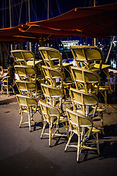 Stacked chairs in the evening - Honfleur Normandy France