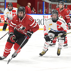 WHITBY, - Dec 13, 2015 -  WJAC Game 2- Team Switzerland vs Team Canada East at the 2015 World Junior A Challenge at the Iroquois Park Recreation Complex, ON. Sam Dunn #11 of Team Canada East and Yannick Lerch #18 of Team Switzerland pursue the play during the second period.(Photo: Andy Corneau / OJHL Images)