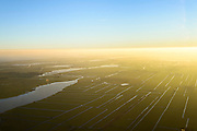Nederland, Noord-Holland, Monnickendam, 11-12-2013; Waterland ter hoogte van Monnickendam. Ooster Ee bij ondergaande zon.<br /> Waterland, north of Amsterdam, with winter sunset<br /> luchtfoto (toeslag op standaard tarieven);<br /> aerial photo (additional fee required);<br /> copyright foto/photo Siebe Swart.