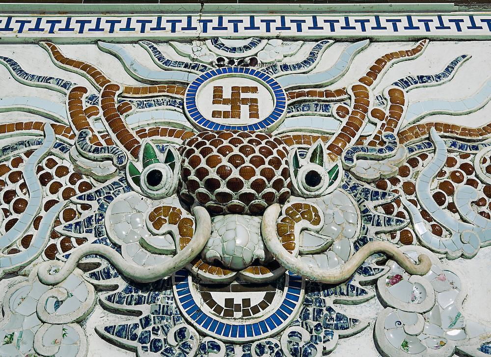 Mosaic panel of dragon and swastika at Long Son Pagoda, near Nha Trang.