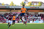 Oldham Athletic striker Aaron Amadi-Holloway (10) heads the ball during the EFL Sky Bet League 1 match between Northampton Town and Oldham Athletic at Sixfields Stadium, Northampton, England on 5 May 2018. Picture by Dennis Goodwin.