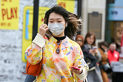 © Licensed to London News Pictures. 11/03/2020. London, UK. A woman wearing a surgical face mask in Oxford Street amid an increased number of cases of Coronavirus (COVID-19) in the UK. Chancellor RISHI SUNAK has unveiled a £30bn package to help the economy get through the coronavirus outbreak in the UK. Photo credit: Dinendra Haria/LNP