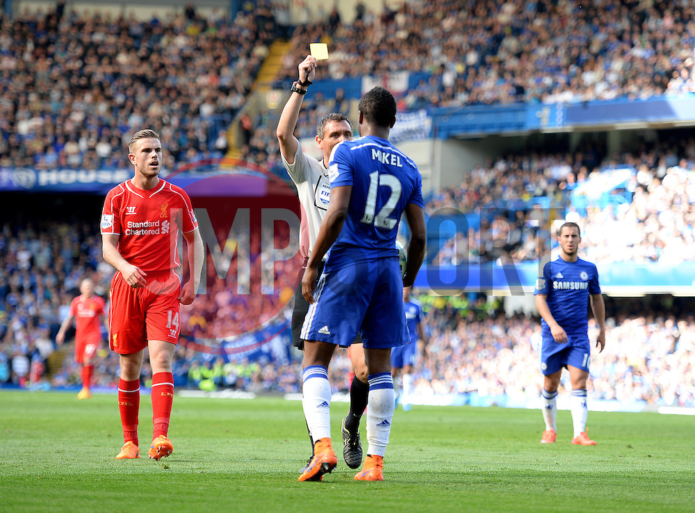 Chelsea's Mikel John Obi is booked by Referee Andre Marriner - Photo mandatory by-line: Alex James/JMP - Mobile: 07966 386802 - 10/05/2015 - SPORT - Football - London - Stamford Bridge - Chelsea v Liverpool - Barclays Premier League