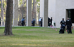 Policemen investigate on the campus of Lone Star College in north Houston, the United States, Jan. 22, 2013. Three people, including a suspect, have been shot on the Lone Star College north campus in Houston on Tuesday, as a result of an argument between a student and a man, authorities said, Houston, USA, January 22, 2013. Photo by Imago / i-Images...UK ONLY