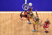 Pamela Cookey (left) and Joanne Harten (right) of England compete for a rebound with Julie Corletto (2nd from left) and Laura Geitz of Australia during their qualification round match of the Netball World Cup at Allphones Arena in Sydney, Australia.