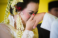 Sundanese bride during traditional wedding ceremony in Cianjur, West Java, Indonesia.
