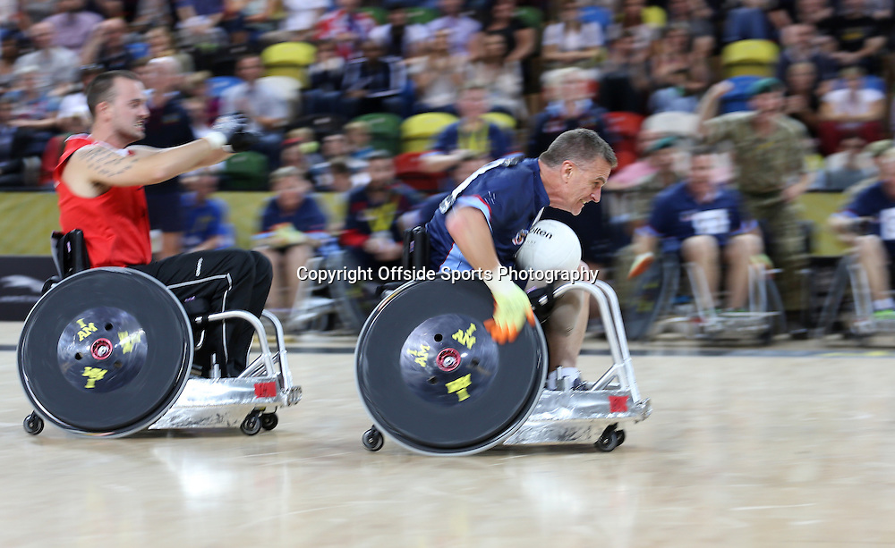 12 September 2014 - Invictus Games Day 2 - The race is on in the Bronze medal match between Denmark and Australia.<br /> <br /> Photo: Ryan Smyth/Offside