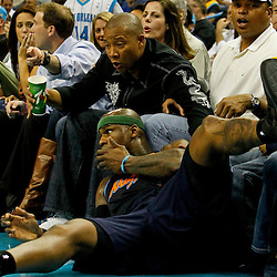 April 4, 2012; New Orleans, LA, USA; Denver Nuggets power forward Al Harrington (7) lands by fans sitting courtside during the second half of a game against the New Orleans Hornets at the New Orleans Arena. The Hornets defeated the Nuggets 94-92.  Mandatory Credit: Derick E. Hingle-US PRESSWIRE