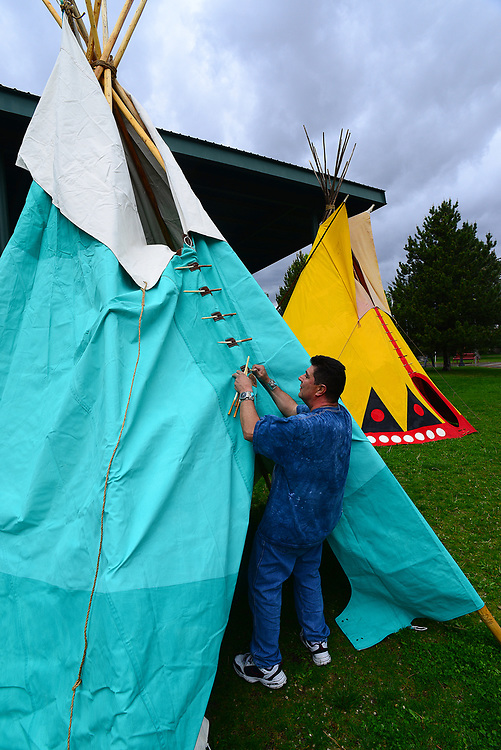 apl042517a/ASECTION/pierre-louis/JOURNAL 042517<br />  Daniel Gallegos,, of San Juan Pueblo installs pegs in the opening flap of a Tipi in preparation for the Gathering of Nations Pow Wow at Expo New Mexico.Photographed on Tuesday April 25, 2017. .Adolphe Pierre-Louis/JOURNAL
