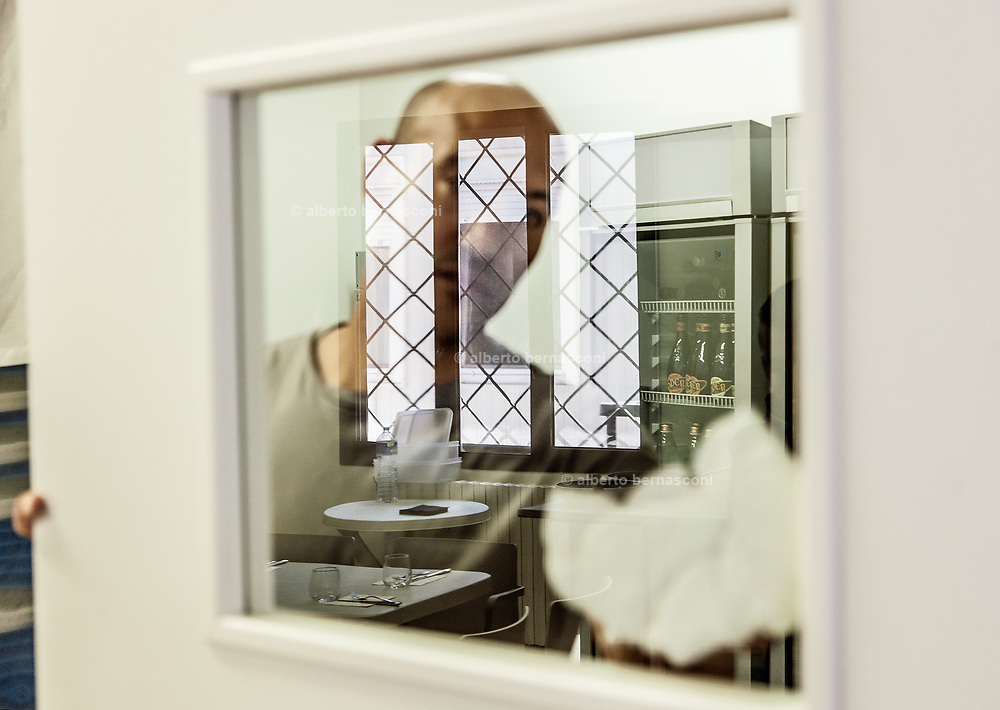 Milan, Bollate, InGalera Restaurant: Said at work, cleaning the door glass between the store room and  kitchen,  and the restaurant room