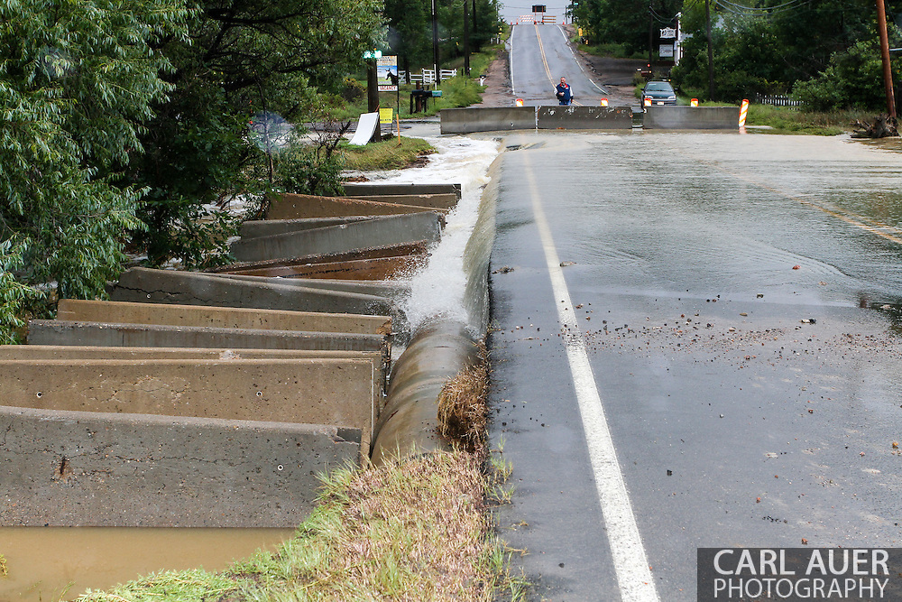 September 15th, 2013:  A view looking south at a closed portion of Indiana Street at 78th, where flood waters caused by the massive rains Colorado has received over the last week rush across the road.