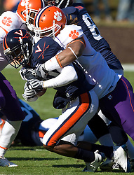 Clemson defensive end Da'Quan Bowers (93) tackles Virginia wide receiver Kevin Ogletree (20) for a loss.The Clemson Tigers defeated Virginia Cavaliers 13-3 in NCAA Division 1 football at Scott Stadium on the Grounds of the University of Virginia in Charlottesville, VA on November 22, 2008.
