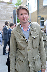 TOM HOOPER at a private view in aid of Chickenshed of Julian Schnabel's first UK solo show of paintings for 15 years entitled 'Every Angel Has A Dark Side' held at the Dairy Art Centre, 7a Wakefield Street, Bloomsbury, London on 24th April 2014.