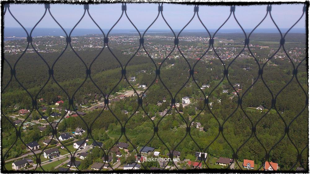 aerial view of tallinn through metal wire