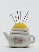 close up of a teapot formed pin cushion