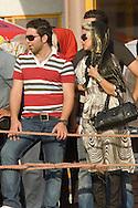 Kezer shahr, North Iran. August 30, 2007- A couple watch a jet ski competition.